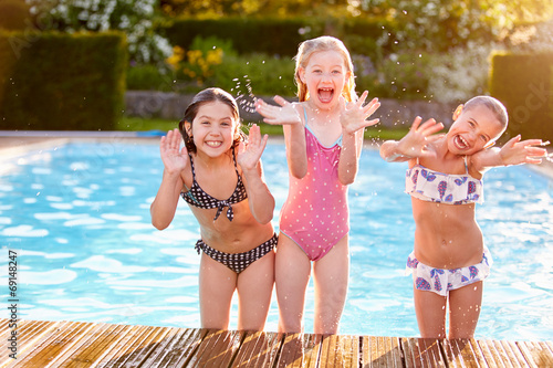 canvas print picture Group Of Girls Playing In Outdoor Swimming Pool