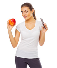 Young girl with red apple and chocolate