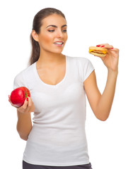 Young girl with red apple and hamburger
