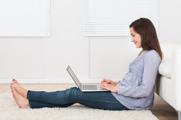 Smiling Woman Using Laptop In House