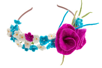 wreath on the head of white and blue flowers with roses