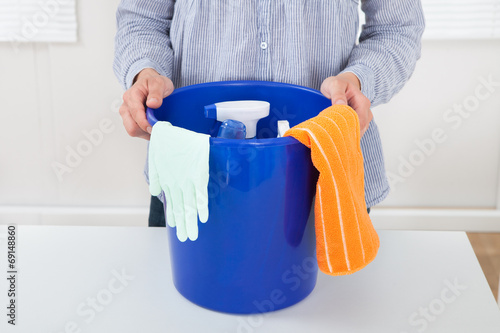 canvas print picture Woman With Cleaning Equipment In Bucket At Table