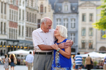 Loving senior couple enjoying city of Leuven, Belgium