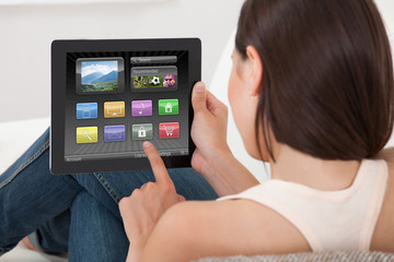 Woman Using Various Applications On Digital Tablet