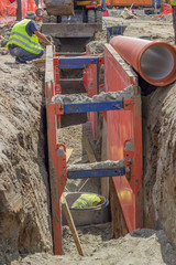 Workers in trench, working on a pipeline 2