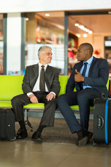 businessmen sitting at airport