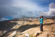 Woman bicyclist taking photo of fantastic himalayas landscape