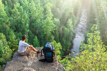 Backpacker looks at beautiful view