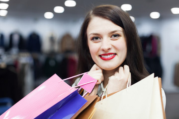 Ordinary woman with shopping bags