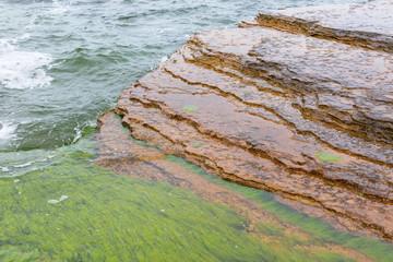 Waves at the shore bedrock