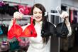 Smiling girl choosing underwear