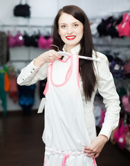 Woman choosing underwear at boutique