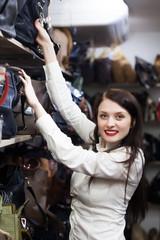 woman choosing bag at store