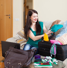 girl packing suitcase for holiday