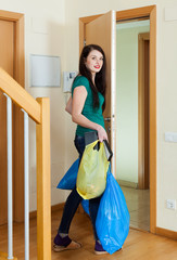 Brunette woman taking away the garbage