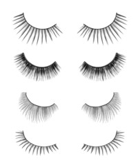 collection of black false eyelashes on an isolated white backgro
