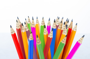 Colorful pencils as smiling faces people isolated