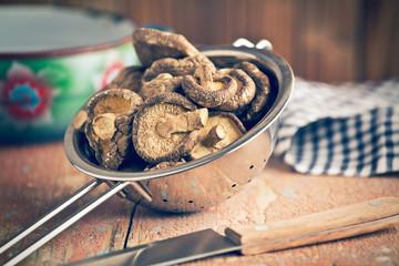 dried shiitake mushrooms in colander