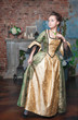 Beautiful woman in medieval dress afraid