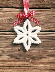 Rustic snowflake decoration on a ribbon