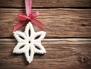 White Christmas snowflake on rustic wood