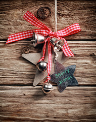 Christmas decoration hanging on a rustic wall