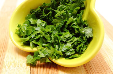 Fresh and natural chopped parsley in yellow dish