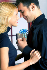 Young attractive couple with gift