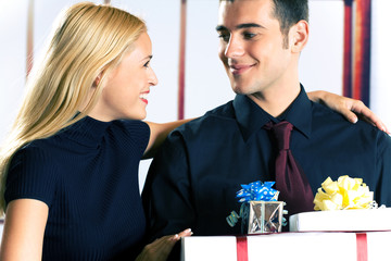 Young attractive couple with gifts