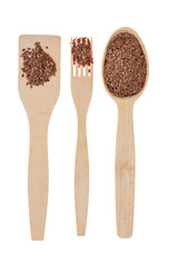 Wooden spoon, fork, paddle with  flax seed