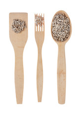 Wooden spoon, fork, paddle with sunflower  seed