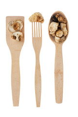 Wooden spoon, fork, paddle with  mushroom