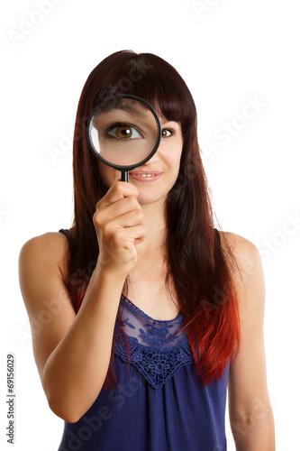 canvas print picture Frau mit Lupe vergrößert ihr Auge