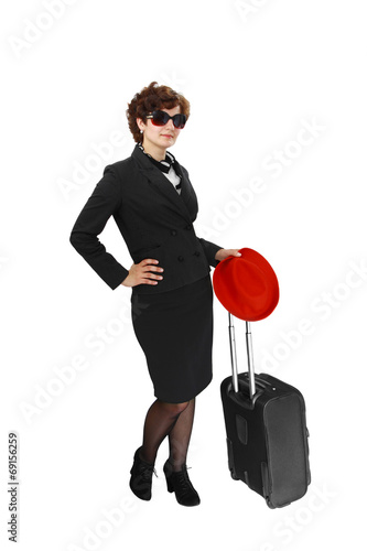 Young woman with suitcase and red hat - 69156259