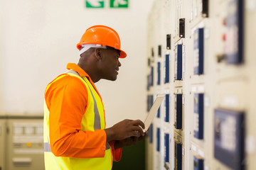 african power company technical worker in control room