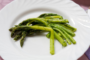 green asparaguses with the fresh dill