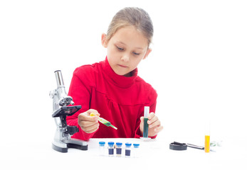 schoolgirl doing research on a white background isolated