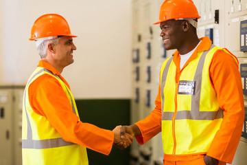 electrical engineers handshaking