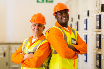 industrial engineers with arms crossed in power plant control ro