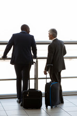 two businesspeople at airport