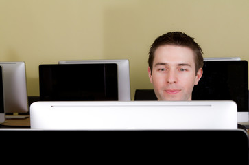 Business man at workplaces in computer room