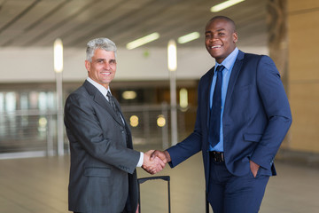 business travellers greeting at airport
