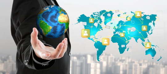 Business man holding the small world in his hand  (Elements of t