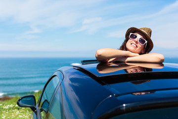 Relaxed woman on summer car vacation travel