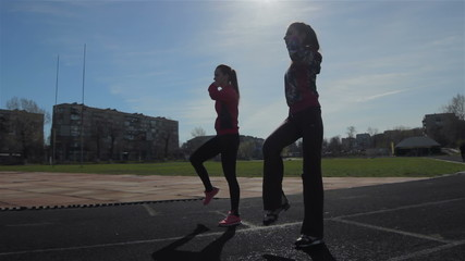 Young girls spend training exercises before the race