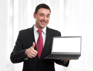 smiling businessman with black laptop screen