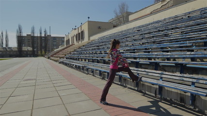 Stretching for legs and feet before the race in the stadium