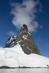 mountain peak at the entrance to the Strait of  Lemaire sunny da