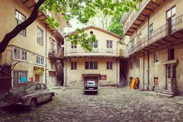 vintage car and old courtyard of the city Lviv
