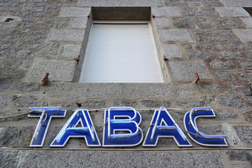 French Tabac Neon sign at facade of a tobacconist